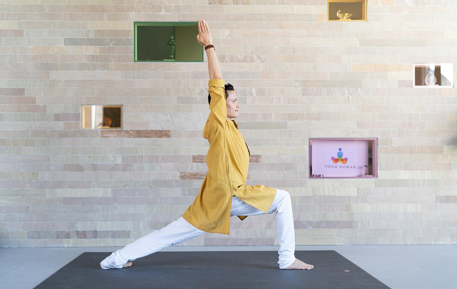 man in warrior pose yoga asana